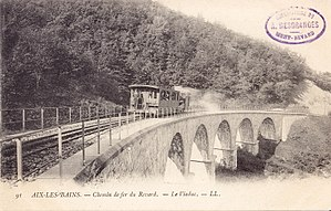 Black and white postcard showing a small train.