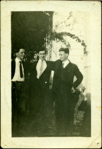 Black-and-white photo of three young men posing.