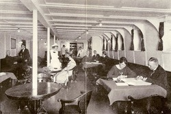 Photograph of a large room on ship