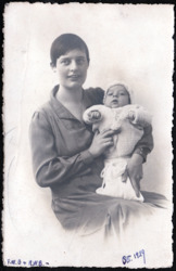 Black and white photo of a woman holding a baby